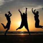 christian-youth-happy-jumping-sunset-beach